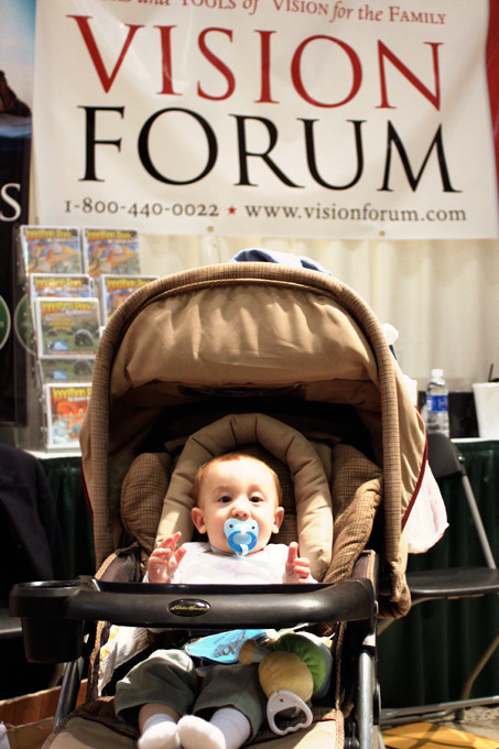 The secret to strong book sales? Strategic position of a cute baby behind the book table.