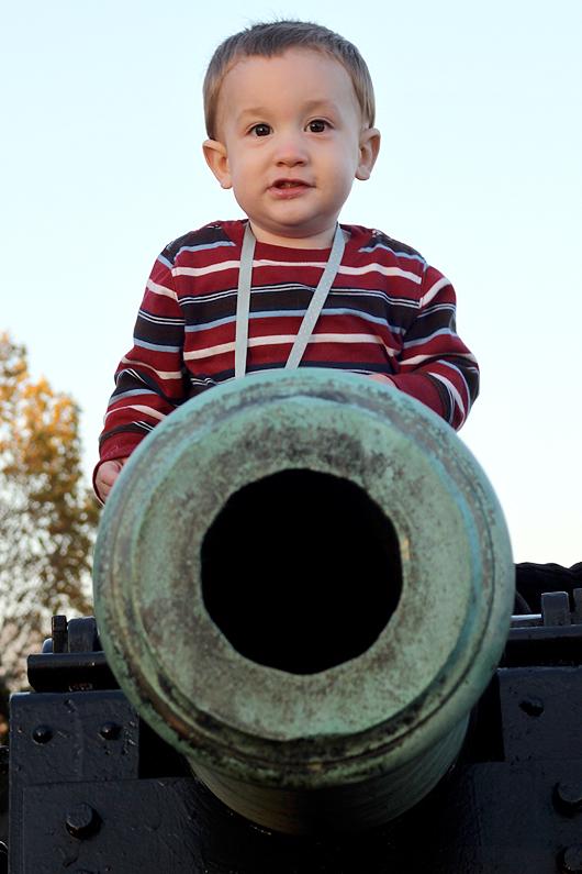 Calvin sits atop a Civil War cannon at Brice's Crossroads battlefield