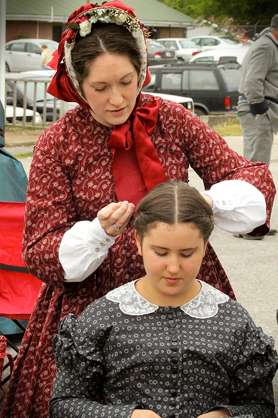 Melissa helps Mary with an 1860s do