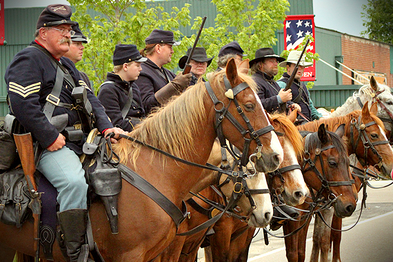 Yankee cavalrymen stand guard after the defeat of the Confederates and burning of the courthouse