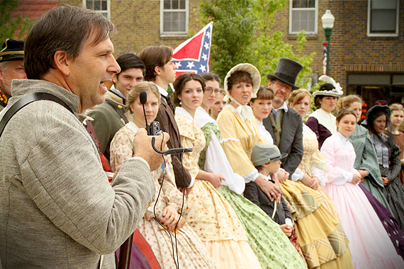 Event organizer Anthony Courter introduces the lineup of those in period garb