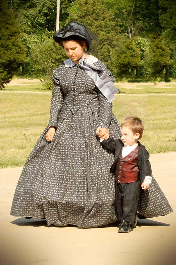 Mrs. Carrie McGavock (Aunt Mary) and Calvin take a stroll at the end of the day